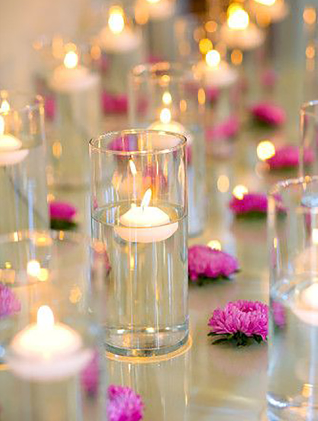 Candles over flowers